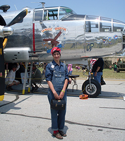 Celia standing by B-25 Mitchell Yankee Warrior